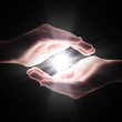 Leinwandbild Motiv cross light in the darkness in your hands