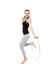 Young woman with the jump rope