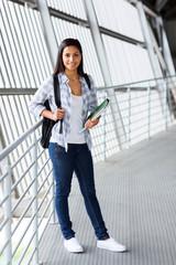university student standing indoors