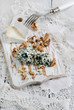 Cutting board with Camembert, blue cheese and walnut