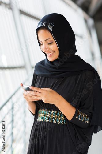 islamic woman using smart phone
