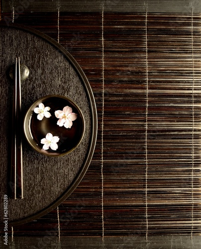 Bowl of cherry blossoms on Japanese black tray