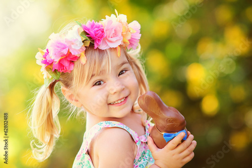 cute easter girl with chocolate bunny - 62802488