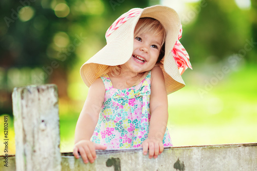canvas print picture Portrait of a happy little girl outdoor
