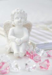 A little miniature statue of a white angel with wings on a white