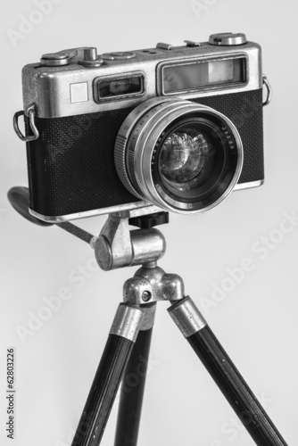 Black and white old camera on tripod