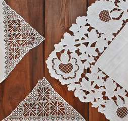 Beautiful vintage doily on a wooden background