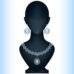 Mannequin with women's jewelery. Silver earrings and necklace wi