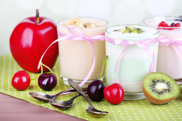 Delicious yogurt with fruits tastes in glasses and fresh fruits