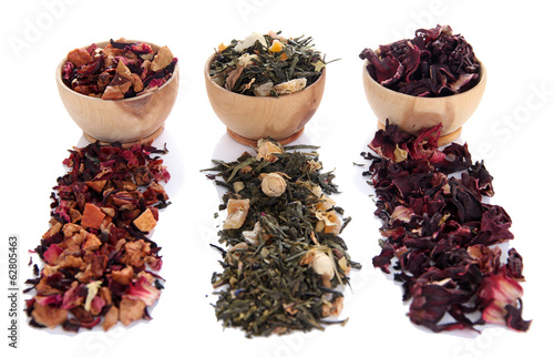 Different kinds of dry tea in bowls isolated on white