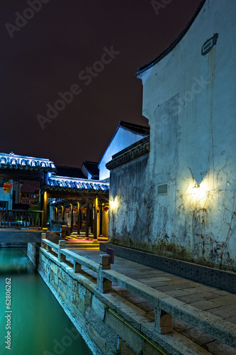 Night scene of traditional building near the river