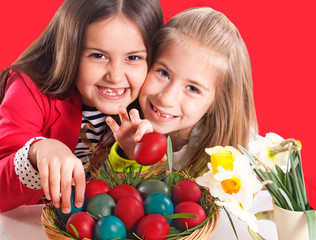 cute little girls with easter eggs