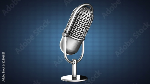 loop rotate Retro microphone on blue background