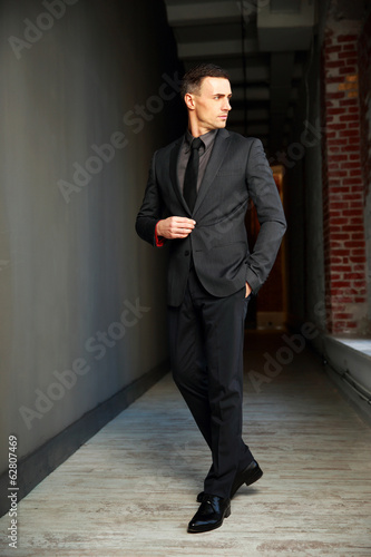 Full-length portrait of a confident businessman