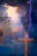 Lightning Stikes toward cross with sunlight streaming