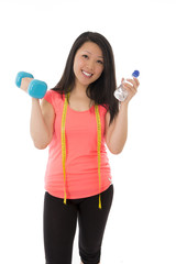 happy asian woman wearing pink shirt holding a dumbbell