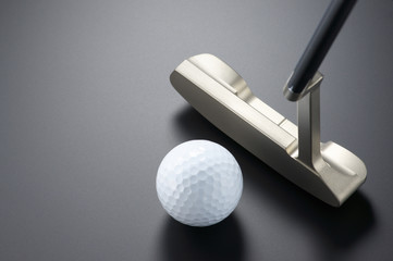 Practicing putter.