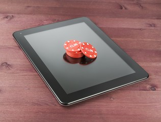 red gambling chips on digital tablet pc,texas game online