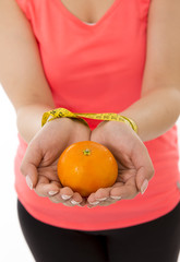 woman hands handcuffed  with measuring tape with orange