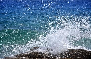 Powerful sea waves crushing a rocky coast