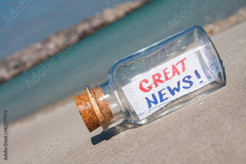 "Message in bottle ""Great news"". Success concept."
