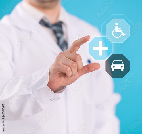 Doctor hand showing medicine symbols on digital screen