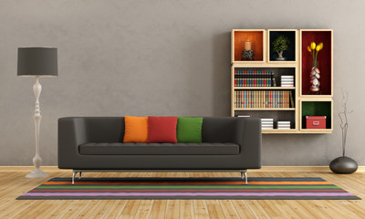 Living room with colorful sofa and bookcase