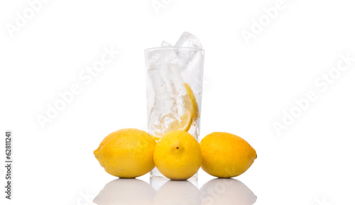 Empty glass and ice cube and lemon fruits