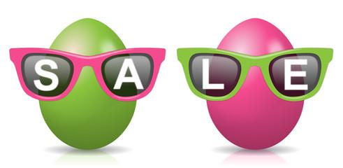 """2 pink-grüne Ostereier mit Sonnenbrillen und Schriftzug """"SALE"""""""