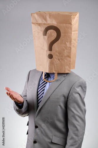 Anonymous businessman with paper bag on his head