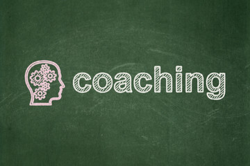 Education concept: Head With Gears and Coaching on chalkboard