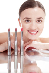 Young smiling woman with glamour red lipsticks, isolated on whit