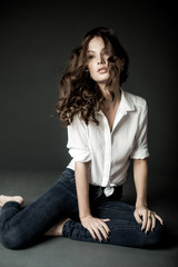 Lovely woman in white blouse and blue jeans