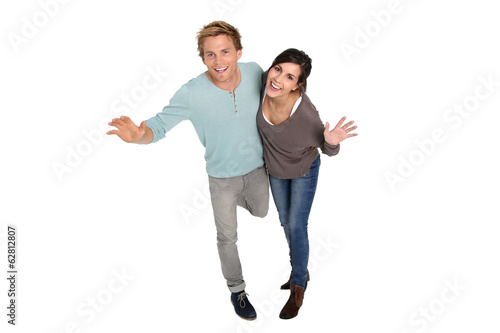 Cheerful couple on white background laughing outloud
