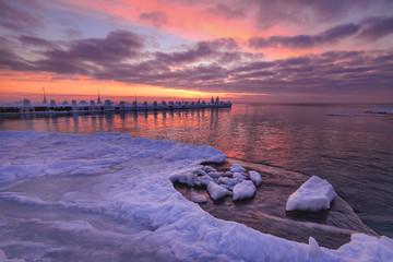 Wave on frozen ocean at sunrise light