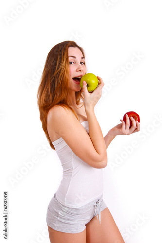 Young, sporty, fit and beautiful girl with apples isolated on wh