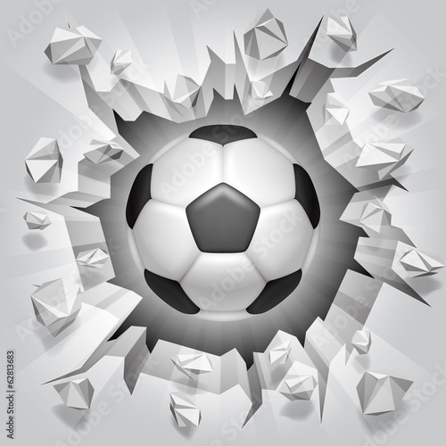 Soccer ball and cracked wall.