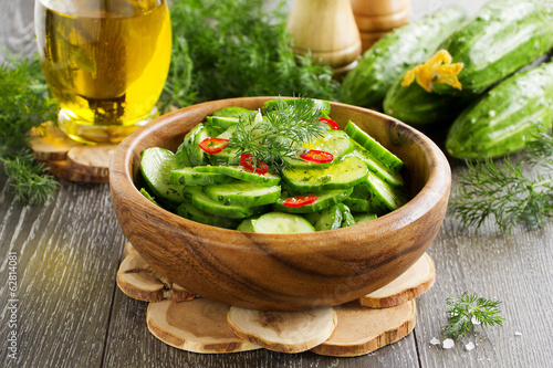 Salad of cucumber, sesame seeds and pepper.