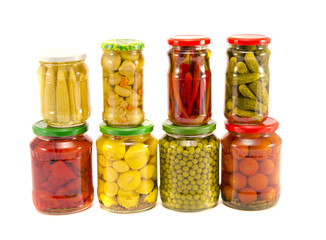collection canned vegetables in glass jars on white