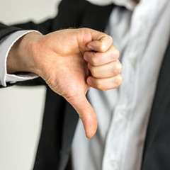 Man giving a thumbs down gesture of disapproval