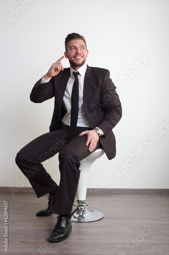businessman pointing head