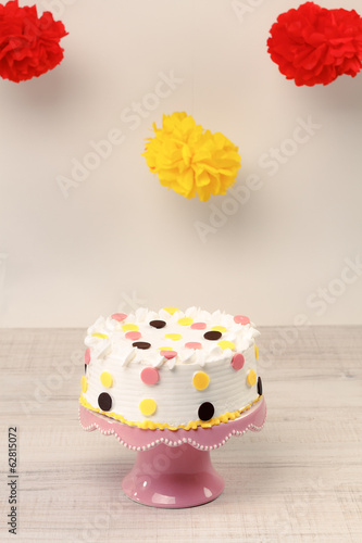 Colorful birthday cake with party decorations