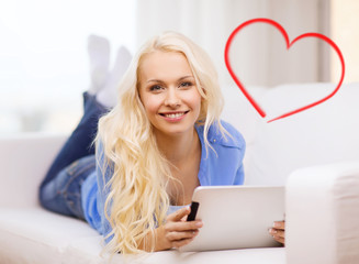 smiling woman with tablet pc computer at home