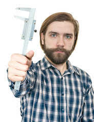 the young man with beard a holding caliper in hand