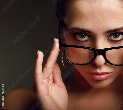 Sexy woman in modern glasses. Closeup vintage portrait