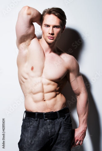 Handsome man with sexy muscular body.