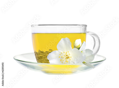 glass cup of green tea with jasmine flowers isolated on white