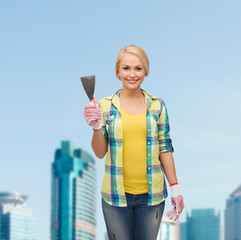 smiling female worker in gloves with spatula