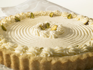 Rare Cheese Tart with pistachio nuts and whipped cream