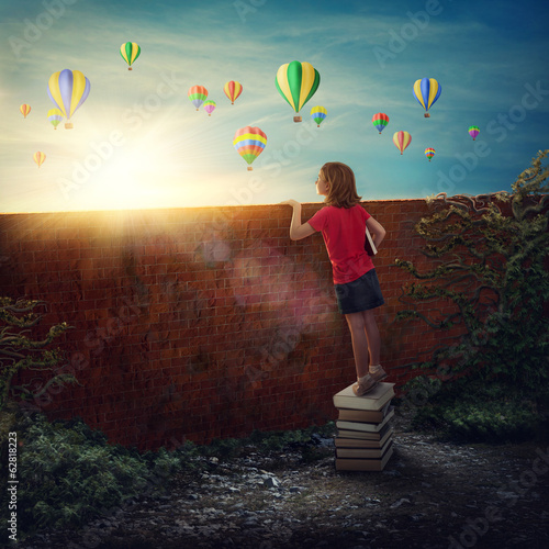 Girl standing on the books